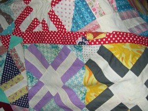 Some of the wonderful 50's fabrics in the quilt and the red and white polka dot border.
